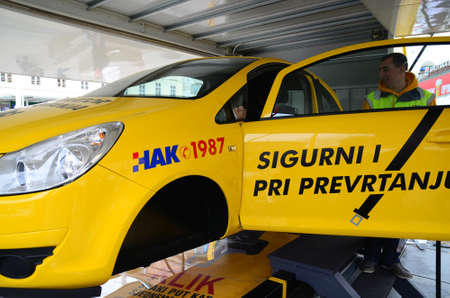 able: Zagreb, Croatia. 17th May 2014. HAK-Croatian Auto Club had an educational program where citizens could get information about traffic safety. Citizens were able to sit in a simulator for the safety of the roll-over car. Editorial