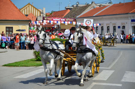 gathered: Croatia Djakovo 6th July, 2014. Last day and procession of international folklore festival Embroideries of akovo which takes place every year in July gathered a large number of participants and visitors. Editorial
