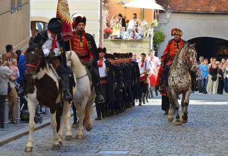 saint marks square: Zagreb,Croatia. 18 Oct 2014. On the occasion of the International tie Day at Saint Marks square in front of Saint Mark church on upper town, Honour Cravat Regiment changing the guard. Editorial