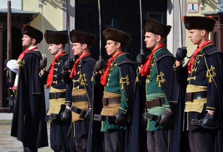 saint mark's square: Zagreb,Croatia. 18 Oct 2014. On the occasion of the International tie Day at Saint Marks square in front of Saint Mark church on upper town, Honour Cravat Regiment changing the guard. Editorial