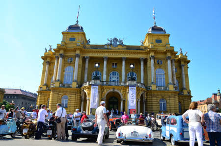 began: Zagreb,Croatia. 08 Jun 2014. In front of the Croatian National Theatre on the Marshal Tito Square started 29th traditional Zagreb oldtimer rally. Visitors were able to see rare vehicles. Start began at 10:00 and the goal of the rally is castle Trakoscan i