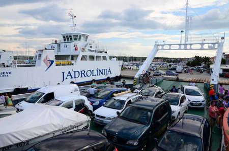 ferries: Biograd,Croatia. 1st Aug, 2014 Tourist season, a large crowd in the ferry port Biograd where Jadrolinija ferries sail to the island of Pasman. Editorial
