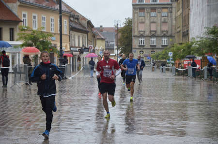 despite: Zagreb,Croatia. 11 Oct 2015. 24th Zagreb marathon despite the heavy rain attracted a large number of participants. Editorial