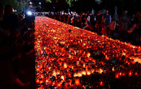 loved: agreb, Croatia. 1st November 2013. On the occasion of the feast of All Saints citizens light candles and lanterns for their dead loved ones at the central cross in the cemetery Mirogoj