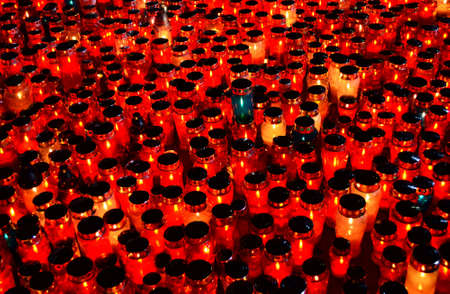 ones: agreb, Croatia. 1st November 2013. On the occasion of the feast of All Saints citizens light candles and lanterns for their dead loved ones at the central cross in the cemetery Mirogoj
