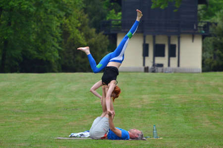 practiced: Zagreb,Croatia. 01.May.2015. A man and woman in the park maksimir practiced interesting balancing exercises.