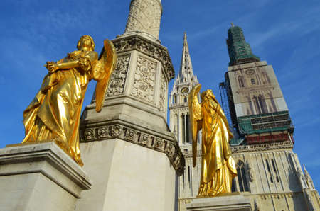 statutes: Golden angels in front of Zagreb Cathedral, Croatia Editorial