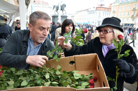 Zagreb,Croatia. 8th March, 2014. On the occasion of International Womens Day, Zagreb Mayor Milan Bandic was shared roses to women at Ban Jelacic Square.