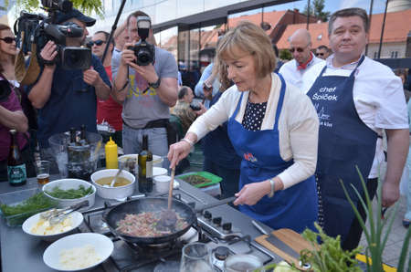 attending: Zagreb, Croatia. 09 May 2015. Celebration of Europe Day at European Square with theme Tastes and sounds of Europe. Minister of Foreign and European Affairs Vesna Pusic attending the event where she cooked for citizens.