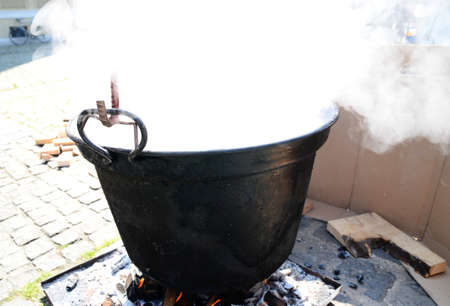 soup kettle: fish stew in big kettle