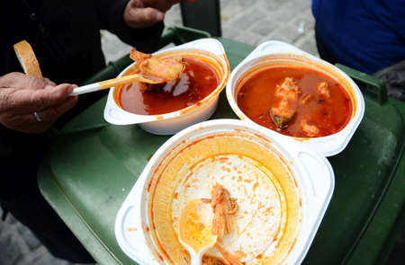 soup kettle: fish stew  in plastic plate