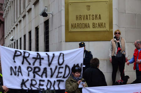 fixed rate: Zagreb,Croatia. 28 Mar 2015. Croatian citizens protest against Swiss Franc loans in front of Croatian National Bank organized by Association Swiss Franc.