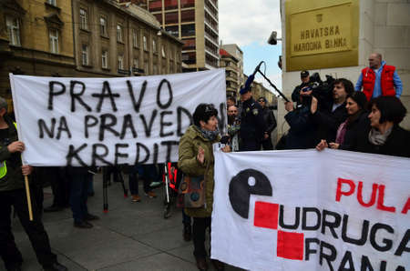 franc: Zagreb,Croatia. 28 Mar 2015. Croatian citizens protest against Swiss Franc loans in front of Croatian National Bank organized by Association Swiss Franc.