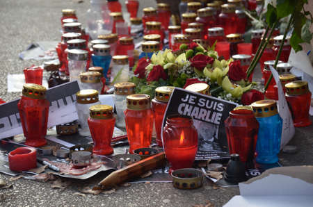 satirical: Zagreb,Croatia.10 Jan 2015. The citizens were lighting candles and lanterns in front of the French Embassy near park Zrinjevac for victims of attacks on the editorial staff of the French satirical magazine Charlie Hebdo