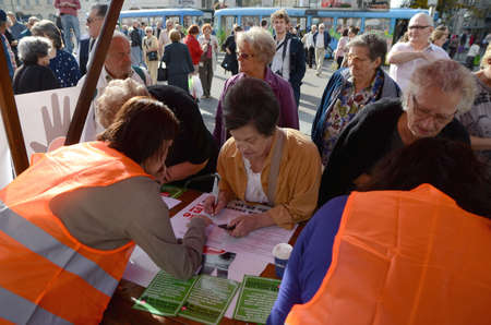 11th: Zagreb,Croatia. 11th Oct, 2014. Collecting signatures for a referendum against the monetization of highway at Ban Josip Jelacic square Editorial