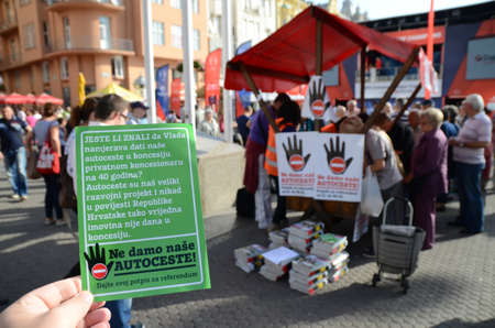 monetization: Zagreb,Croatia. 11th Oct, 2014. Collecting signatures for a referendum against the monetization of highway at Ban Josip Jelacic square Editorial