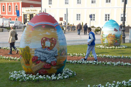 giant easter egg: Zagreb,Croatia. 19th March. Croatian Easter Eggs from the Hearth- on the occasion of Easter, three large eggs are placed in front of Cathedral.