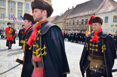 cravat: agreb, Croatia. 23 Apr 2016. Honorary Cravat Regiment demonstrates changing of the guard at St. Marks Square.