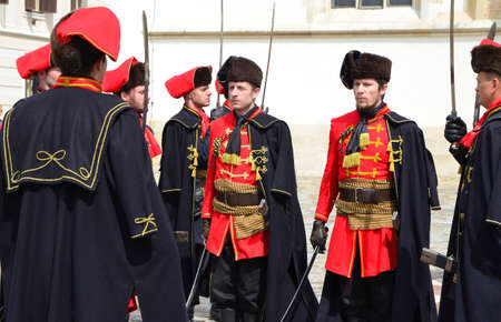 st marks square: agreb, Croatia. 23 Apr 2016. Honorary Cravat Regiment demonstrates changing of the guard at St. Marks Square.