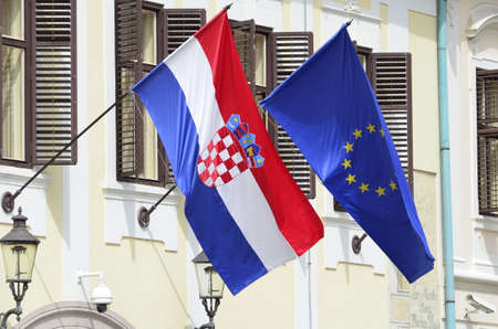 croatian: Croatian and  European Union flags  on government building, Zagreb,Croatia.