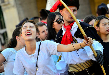 10th: Zagreb, Croatia. 10th July 2016. Celebration of Day of the Cravat Regiment on the Dolac market.Citizens and tourists took part in the military challenges.