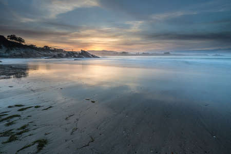spectacular reflections of the sunset on the beaches of Galicia Stock Photo