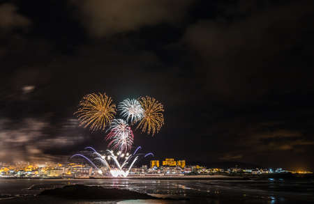holiday in the Galician coast, where at night the festivities in the town of Foz, spain, we contemplate the fireworks worthy of admiration 스톡 콘텐츠
