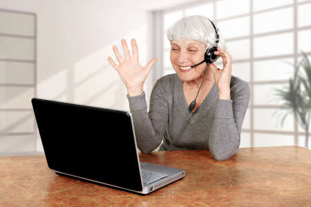 elderly woman at the computer communicates, mother, grandmother