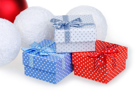 Christmas gift red, white and blue box with a bow on a white background