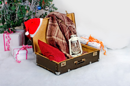 Christmas new year card suitcase Santa Claus with gifts Zdjęcie Seryjne