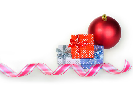 new year Christmas gift red, white and blue box with a bow on a white background Zdjęcie Seryjne