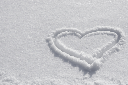 White snow with drown heart shape. heart drawn in the snow. background for valentines day Zdjęcie Seryjne