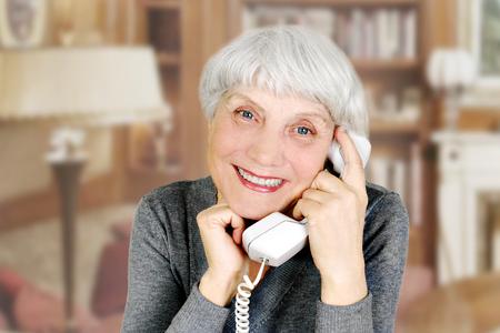 elderly woman speaks on the phone, mother, grandmother