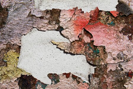 Blank background for your text. The texture of a grunge old street on the facade wall with cracked paint