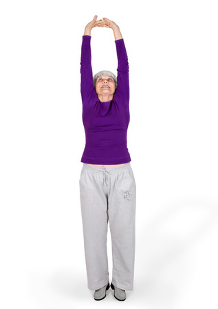 happy charming beautiful elderly woman doing exercises while working out playing sports. On a white background Zdjęcie Seryjne - 81776825