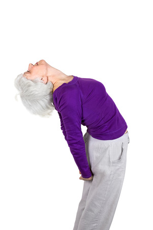happy charming beautiful elderly woman doing exercises while working out playing sports. On a white background Zdjęcie Seryjne