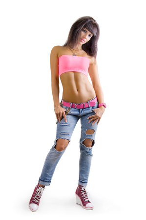 Beautiful sexy glamorous young girl sporting a slender woman in a fashionable jeans on a white background Zdjęcie Seryjne