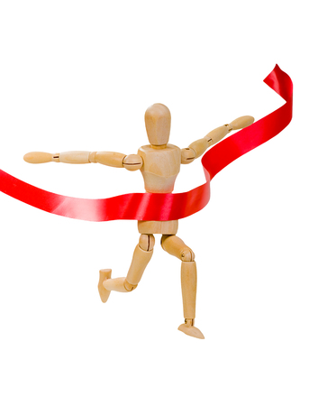 Wooden figure of a man running a leader on a white background with red ribbon