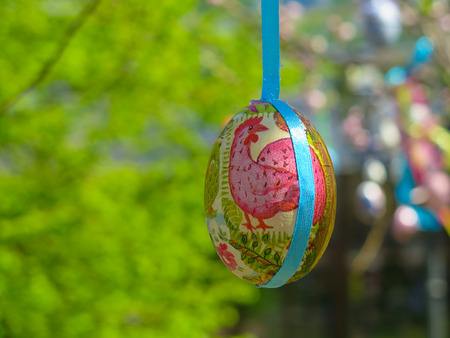 Decorative tree decorated with decorated Easter eggs. National Tadic. Christian Orthodox religious festival.