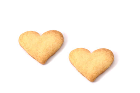 Sweet biscuits in shape of hearts  isolated  photo