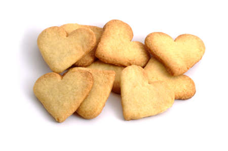 Sweet biscuits in shape of hearts  isolated Stock Photo - 13029751