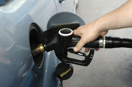 refuel: Man fueling car with diesel Stock Photo