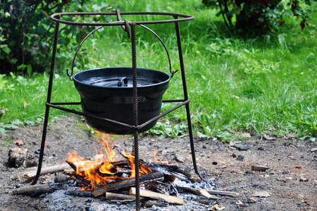 Hungarian Goulash - tripod campfire cooking in cauldron Stock Photo - 13228640