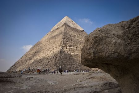 chephren: The Pyramid of Khafrae is the second largest of the Ancient Egyptian Pyramids of Giza and the tomb of the fourth-dynasty pharaoh Khafre (Chephren in Greek), The pyramid has a base length of 215.25 m (706 ft) and originally rises to a height of 143.5 m (47