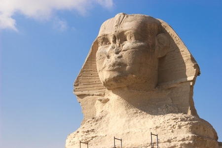 The Great Sphinx of Giza is a statue of a reclining lion with a human head that stands on the Giza Plateau on the west bank of the Nile, near modern-day Cairo, in Egypt. It is the largest monolith statue in the world, standing 73.5 m (241 ft) long, 6 m (2