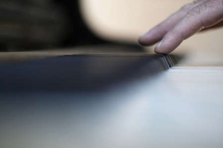 acoustically: male fingers barely touching keys of piano