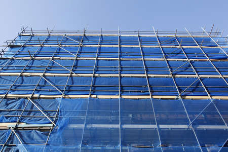 looking up to blue scaffolding and blue sky