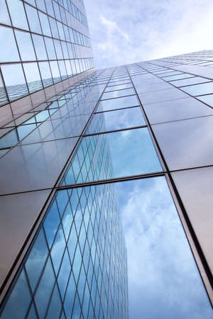 modern facade of glass and steel with reflections of the blue sky photo