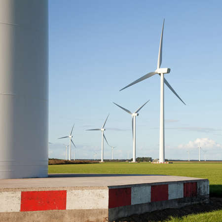 windturbines in Flevoland and blue sky photo