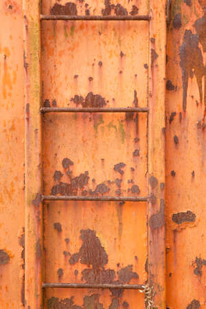 four steps of old orange and rusty container on vertical image Stock Photo - 16808184